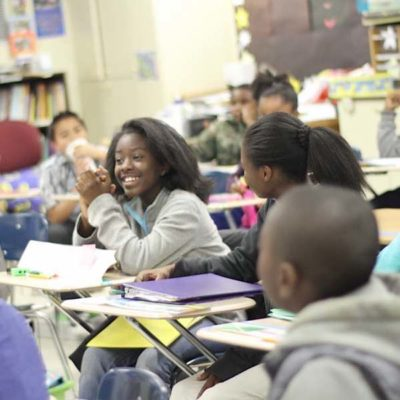 Poetry Inside Out students in an classroom