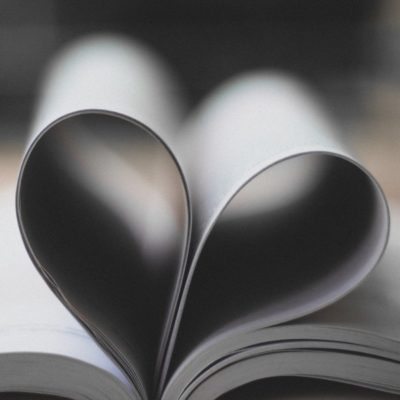 open book with pages folded to make a heart shape