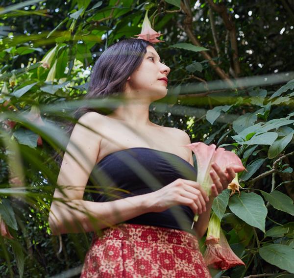 photo of Jazmina Barrera with plants