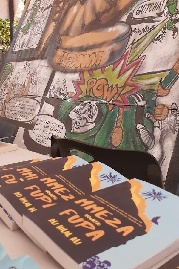 Mural with stack of books in foreground
